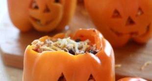 Stuffed peppers with shredded chicken, black beans and Mexican rice. Great for a...